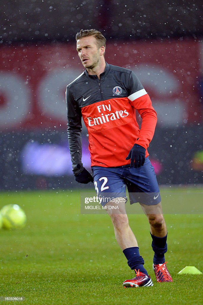 Paris Saint-Germain's British midfielder, David Beckham, warms up before the French L1 football match Paris Saint-Germain (PSG) vs Olympique de Marseille (OM) on February 24, 2013 at the Parc des Princes stadium in Paris. AFP PHOTO MIGUEL MEDINA