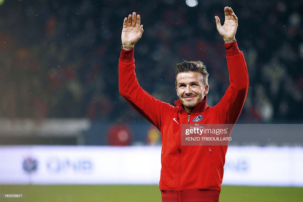 Paris Saint-Germain's British midfielder, David Beckham waves to the crowd before the French L1 football match Paris Saint-Germain (PSG) vs Olympique de Marseille (OM) on February 24, 2013 at the P...