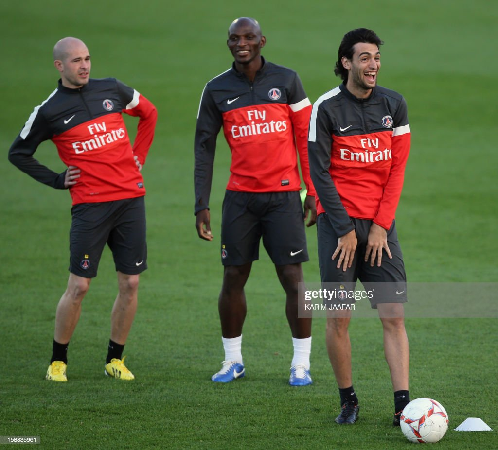 Paris Saint-Germain's Christophe Jallet (L) , Zoumana Camara (C) and Javier Pastore (R) attend a training at the Aspire Academy of Sports Excellence in the Qatari capital Doha on December 31, 2012. PSG is in Qatar for a week-long training camp before the resumption of the French Ligue 1 after the winter break.
