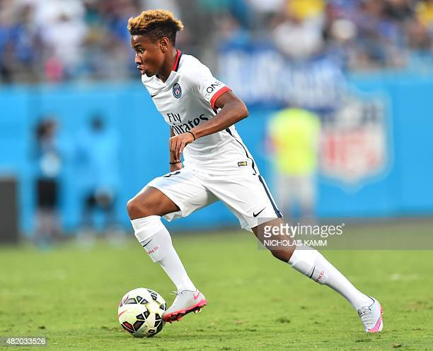 Paris SaintGermain's Christopher Nkunku runs with the ball during an International Champions Cup football match against Chelsea in Charlotte North...
