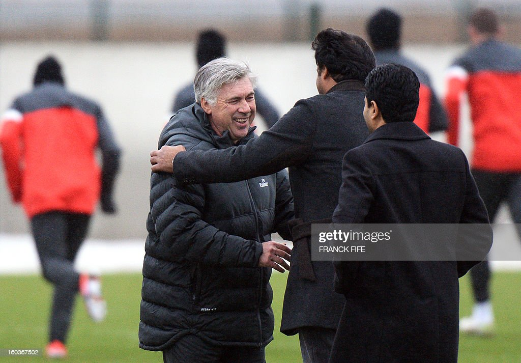 Paris Saint-Germain's coach Carlo Ancelotti, Chairman of the Paris Saint-Germain L1 football club speaks with Nasser Al-Khelaifi (L) of Qatar and Qatari Crown Prince and PSG owner Tamim bin Hamad Al-Thani during a training session on January 30, 2013 at the Camp des Loges in Saint-Germain-en-Laye, west of Paris. AFP PHOTO / FRANCK FIFE