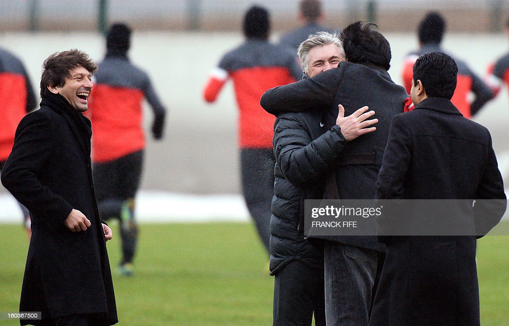 Paris Saint-Germain's coach Carlo Ancelotti (C), hugs Chairman of the Paris Saint-Germain L1 football club, Nasser Al-Khelaifi (2ndRL) of Qatar as Paris Saint-Germain's sporting director Brazilian Leonardo and Qatari Crown Prince and PSG owner Tamim bin Hamad Al-Thani look on during a training session on January 30, 2013 at the Camp des Loges in Saint-Germain-en-Laye, west of Paris. AFP PHOTO / FRANCK FIFE