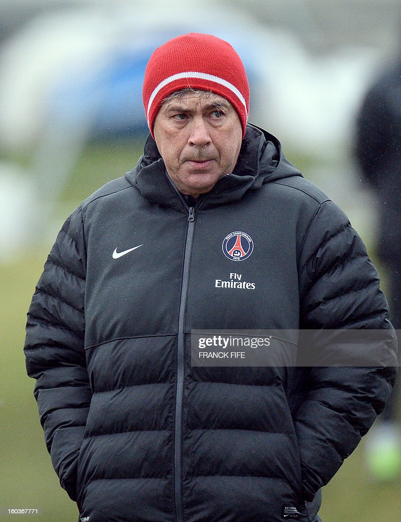 Paris Saint-Germain's coach Carlo Ancelotti looks as his players during a training session on January 30, 2013 at the Camp des Loges in Saint-Germain-en-Laye, west of Paris.
