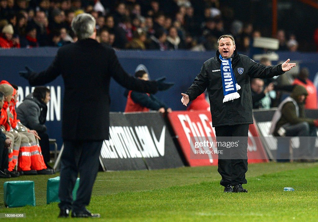 Paris Saint-Germain's coach Carlo Ancelotti reacts next to his Bastia's counterpart Frederic Hantz during the French L1 football match Paris Saint-Germain (PSG) vs Bastia, on February 8, 2013 at the Parc des Princes stadium in Paris. Paris won 3 to 1.
