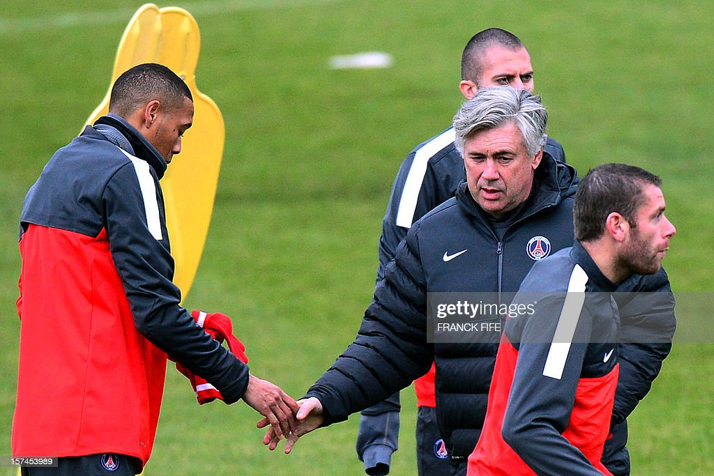 Paris Saint-Germain's coach Carlo Ancelotti (C) shakes hands Paris Saint-Germain's French forward Guillaume Hoarau (L) during a training session in Saint-Germain-en-Laye, west of Paris, on December 3, 2012 on the eve of the UEFA Champions League Group A football match between PSG and Porto.