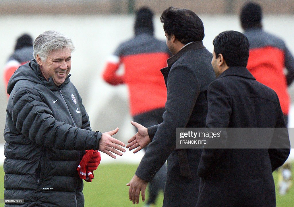 Paris Saint-Germain's coach Carlo Ancelotti (L) shakes hands with Qatari Crown Prince and PSG owner Tamim bin Hamad Al-Thani beside Chairman of the Paris Saint-Germain L1 football club, Nasser Al-Khelaifi (R) of Qatar during a training session on January 30, 2013 at the Camp des Loges in Saint-Germain-en-Laye, west of Paris.