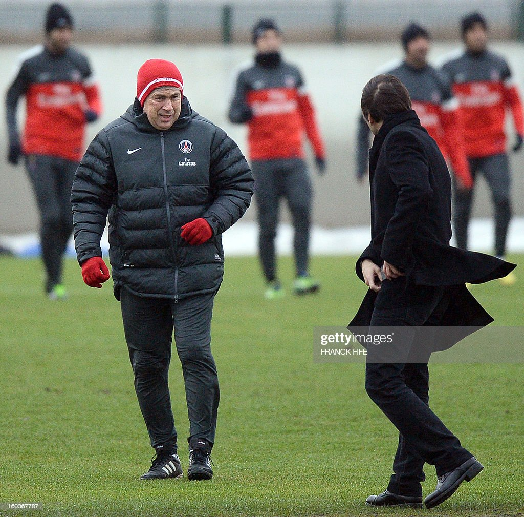 Paris Saint-Germain's coach Carlo Ancelotti (L) speaks with Paris Saint-Germain's sporting director Brazilian Leonardo during a training session on January 30, 2013 at the Camp des Loges in Saint-Germain-en-Laye, west of Paris.