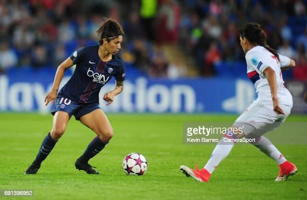Paris SaintGermain's Cristiane under pressure from Olympique Lyonnais' Amel Majri during the UEFA Women's Champions League Final match between Lyon...