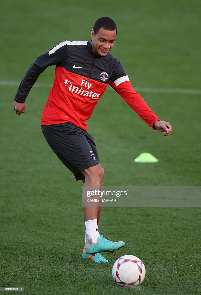 Paris Saint-Germain's (PSG) defender Gregory Van Der Wiel attends a football training session at the Aspire Academy of Sports Excellence in the Qatari capital Doha on December 31, 2012. PSG is in Qatar for a week-long training camp before the resumption of the French Ligue 1 after the winter break.