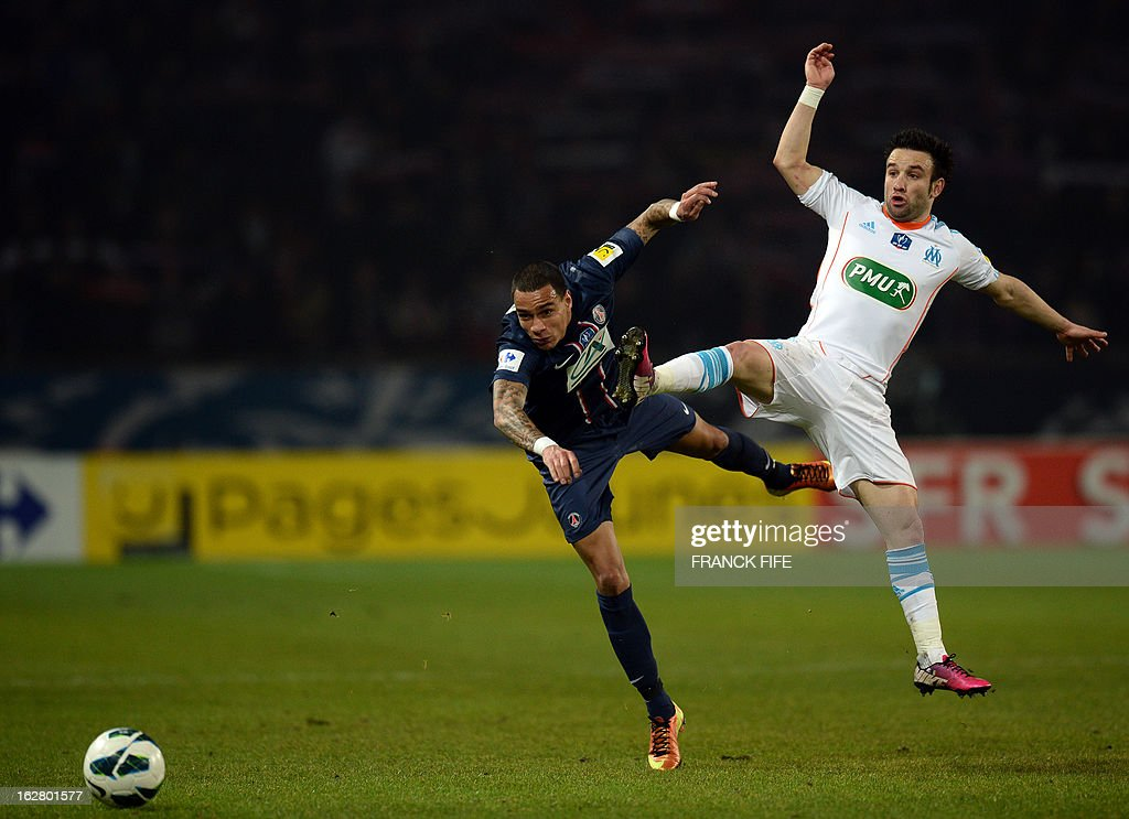 Paris Saint-Germain's defender Gregory Van Der Wiel from Netherlands (L) vies with Marseille's French midfielder Mathieu Valbuena during the French Cup football match Paris Saint-Germain (PSG) vs Olympique de Marseille (OM) on February 27, 2013 at the Parc-des-Princes stadium in Paris.