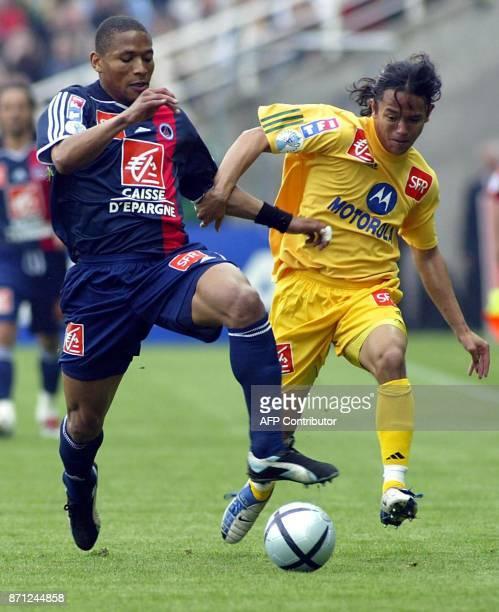Paris SaintGermain's defender José PierreFanfan vies with Nantes forward Marama Vahirua during their French Cup semi final soccer match 28 April 2004...