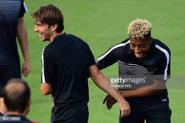 Paris SaintGermain's defenders Maxwell and Presnel Kimpembe share a laugh during a training session on the eve of the UEFA Champions League football...