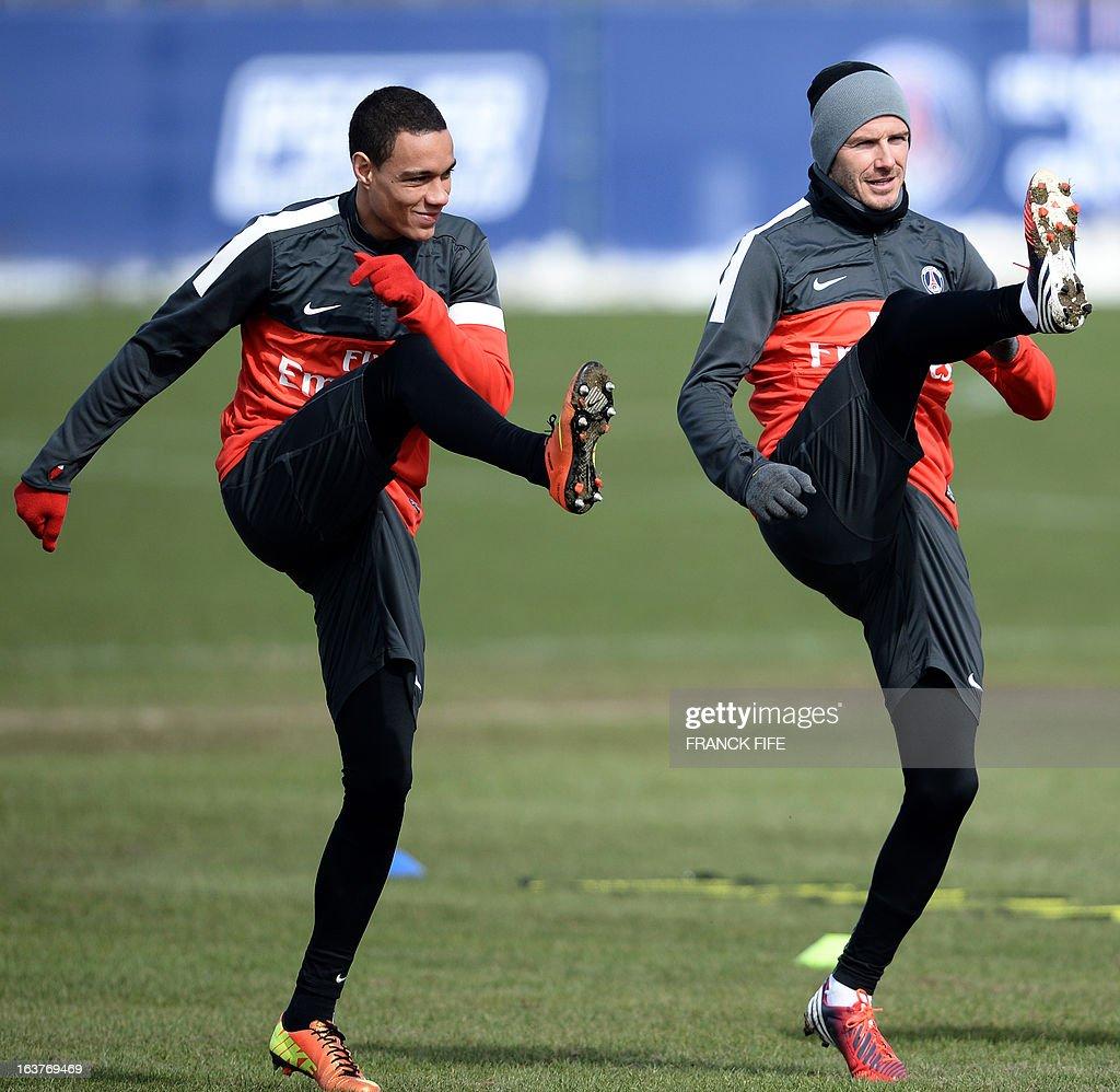 Paris Saint-Germain's Dutch defender Gregory Van Der Wiel (L) and Paris Saint-Germain's English midfielder David Beckham take part in a training session, on March 15, 2013 at the Camp des Loges, the PSG football club training center in Saint-Germain-en-Laye, west of Paris. AFP PHOTO/FRANCK FIFE