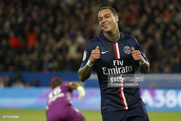 Paris SaintGermain's Dutch defender Gregory Van der Wiel celebrates after scoring his team's third goal during the French L1 football match between...