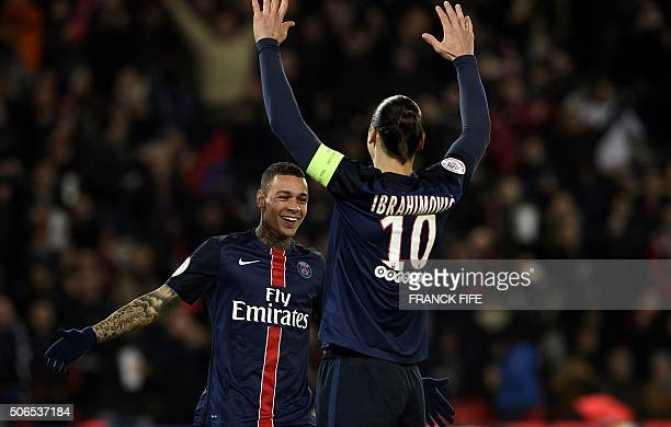 Paris SaintGermain's Dutch defender Gregory Van der Wiel celebrates his goal in front Paris SaintGermain's Swedish forward Zlatan Ibrahimovic during...