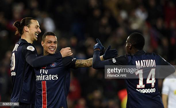 Paris SaintGermain's Dutch defender Gregory Van der Wiel celebrates with Paris SaintGermain's Swedish forward Zlatan Ibrahimovic and and French...