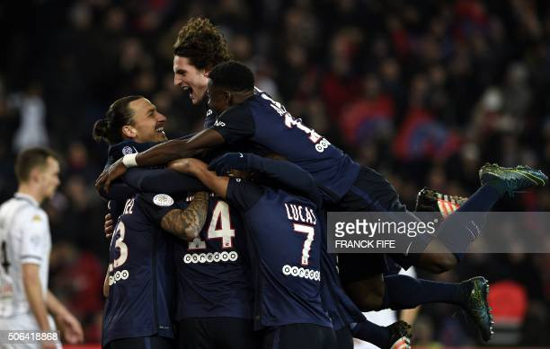 Paris SaintGermain's Dutch defender Gregory Van der Wiel is congratulated by teammates after scoring a goal during the French L1 football match...