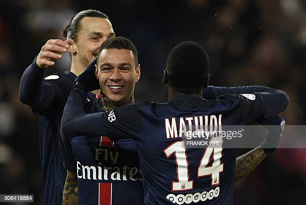 Paris SaintGermain's Dutch defender Gregory Van der Wiel is congratulated by Paris SaintGermain's Swedish forward Zlatan Ibrahimovic and Paris...