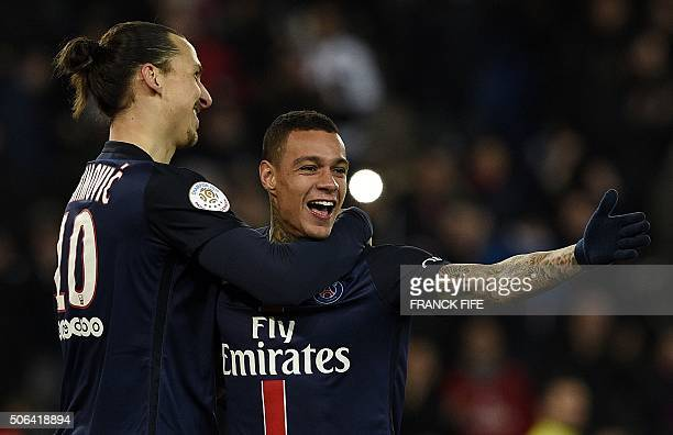 Paris SaintGermain's Dutch defender Gregory Van der Wiel is congratulated by Paris SaintGermain's Swedish forward Zlatan Ibrahimovic after scoring a...
