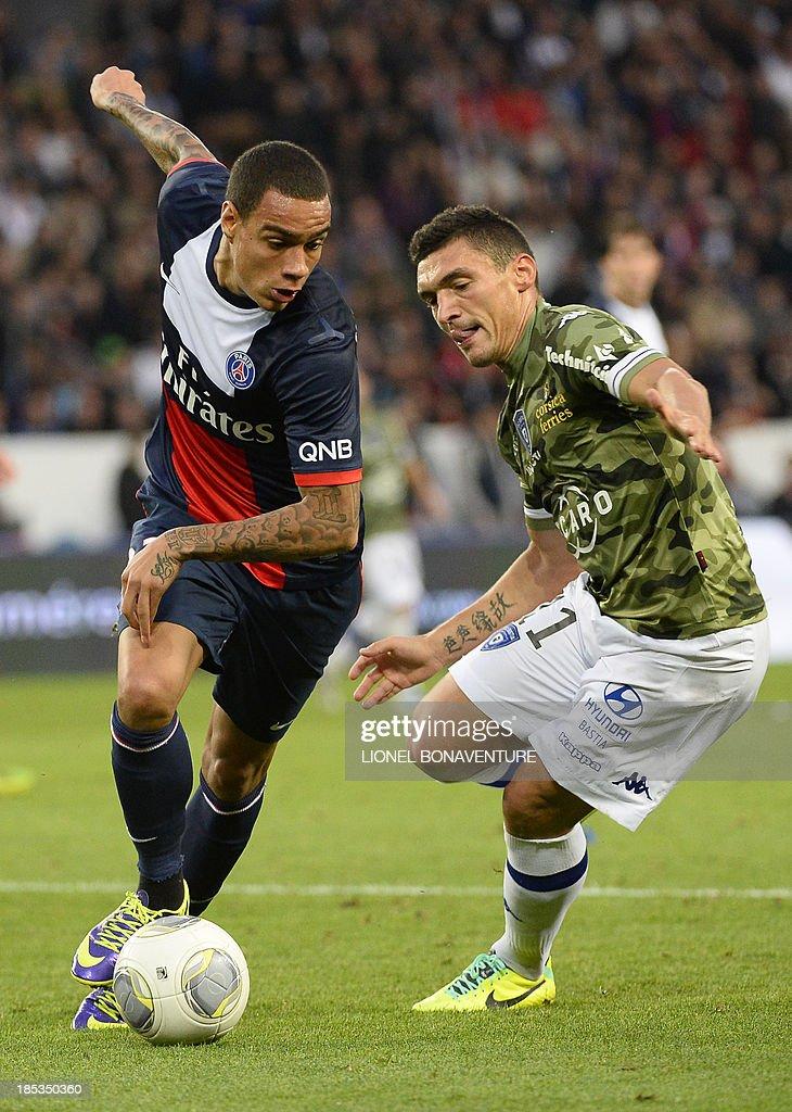 Paris SaintGermain's Dutch defender Gregory Van der Wiel vies with Bastia's Algerian defender Fethi Harek during the French L1 football match Paris...