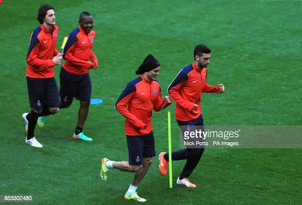 Paris SaintGermain's Edinson Cavani jogs together Javier Pastore waiting their turn during training session at Stamford Bridge London