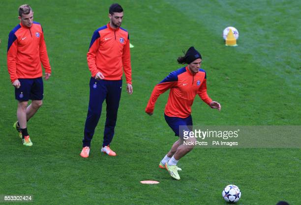 Paris SaintGermain's Edinson Cavani on the ball with Javier Pastore and Lucas Digne waiting their turn during training session at Stamford Bridge...