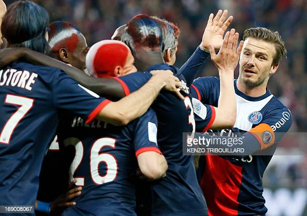 Paris SaintGermain's English midfielder David Beckham celebrates a goal by Paris SaintGermain's French midfielder Blaise Matuidi during a French L1...