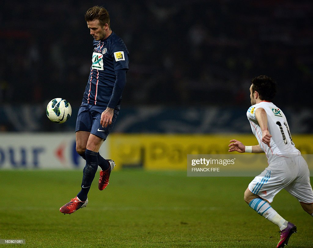 Paris Saint-Germain's English midfielder David Beckham controls the ball during the French Cup football match Paris Saint-Germain vs Marseille February 27, 2013 at the Parc des Princes stadium in Paris.