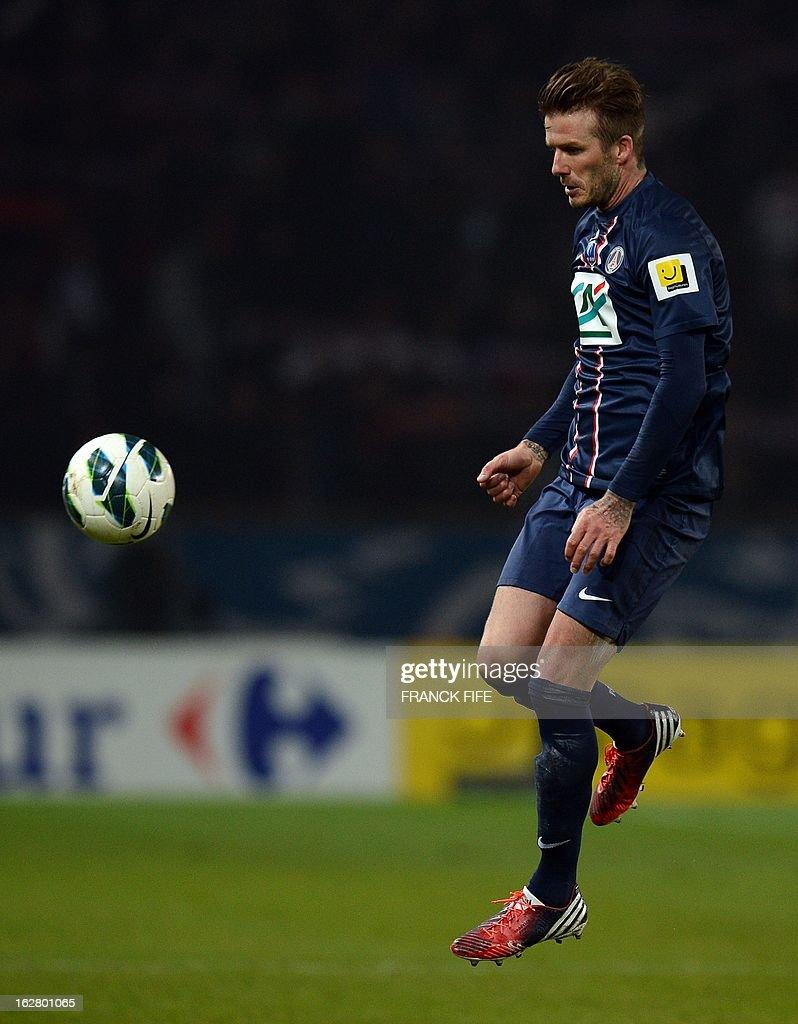 Paris Saint-Germain's English midfielder David Beckham controls the ball during the French Cup football match Paris Saint-Germain vs Marseille, on February 27, 2013 at the Parc des Princes stadium in Paris.