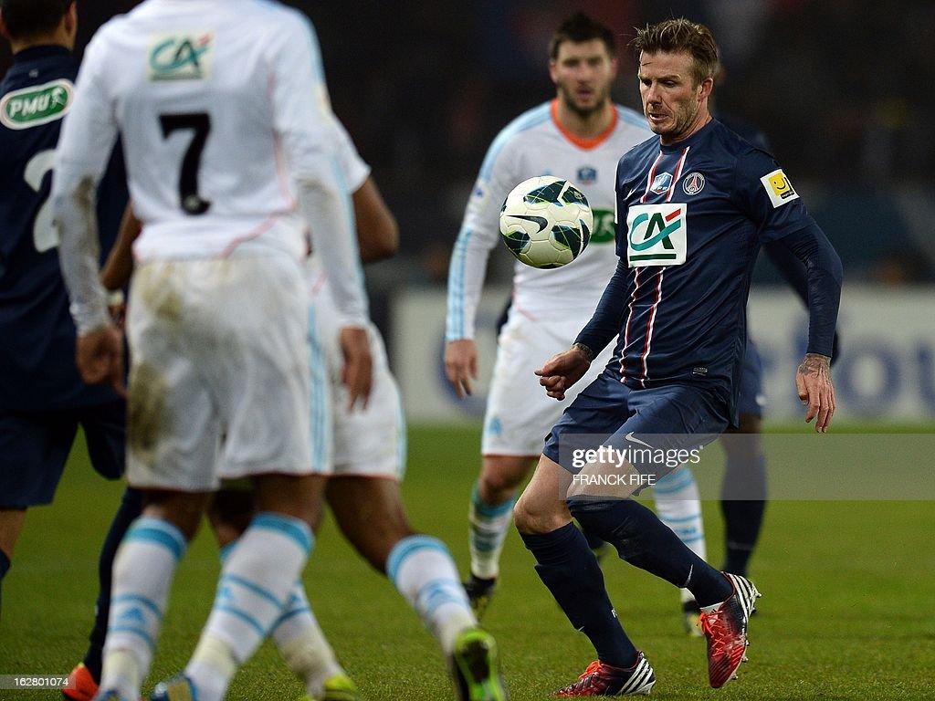 Paris Saint-Germain's English midfielder David Beckham (R) controls the ball during the French Cup football match Paris Saint-Germain (PSG) vs Olympique de Marseille (OM) on February 27, 2013 at the Parc-des-Princes stadium in Paris. AFP PHOTO / FRANCK FIFE