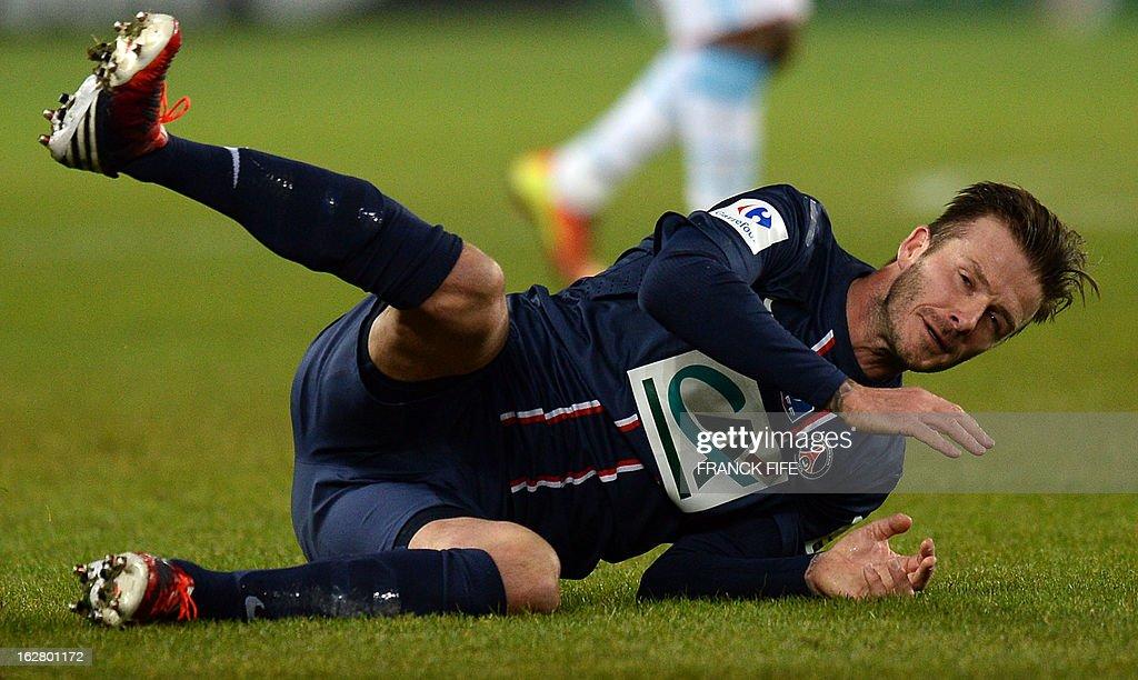 Paris Saint-Germain's English midfielder David Beckham falls during the French Cup football match Paris Saint-Germain (PSG) vs Olympique de Marseille (OM) on February 27, 2013 at the Parc-des-Princes stadium in Paris. AFP PHOTO / FRANCK FIFE