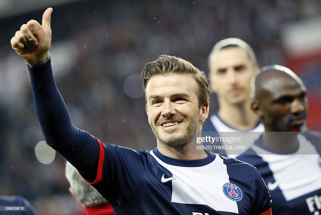 Paris Saint-Germain's English midfielder David Beckham gives a thumbs up during a French L1 football match between Paris St Germain and Brest on May 18, 2013 at Parc des Princes stadium in Paris.
