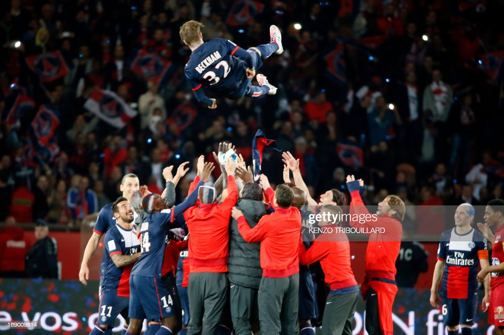 Paris Saint-Germain's English midfielder <a gi-track='captionPersonalityLinkClicked' href=/galleries/search?phrase=David+Beckham&family=editorial&specificpeople=158480 ng-click='$event.stopPropagation()'>David Beckham</a> (C) is thrown into the air after the French L1 football match between Paris St Germain and Brest on May 18, 2013 at Parc des Princes stadium in Paris.