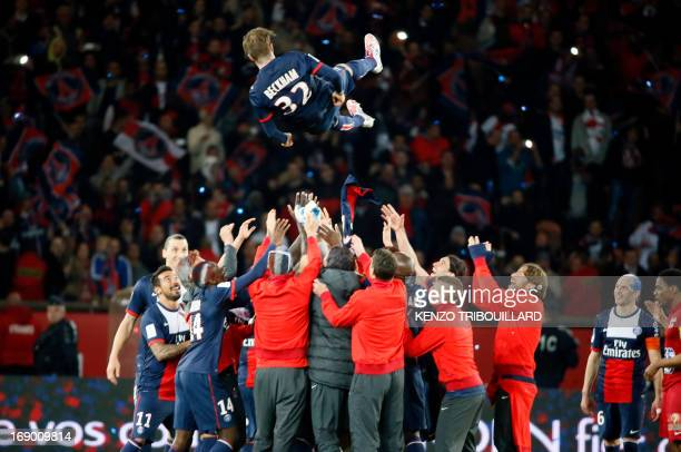 Paris SaintGermain's English midfielder David Beckham is thrown into the air after the French L1 football match between Paris St Germain and Brest on...
