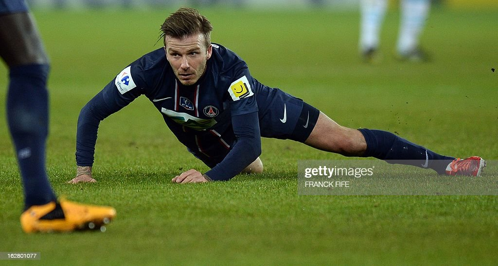 Paris Saint-Germain's English midfielder David Beckham lies on the pitch during the French Cup football match Paris Saint-Germain (PSG) vs Olympique de Marseille (OM) on February 27, 2013 at the Parc-des-Princes stadium in Paris.
