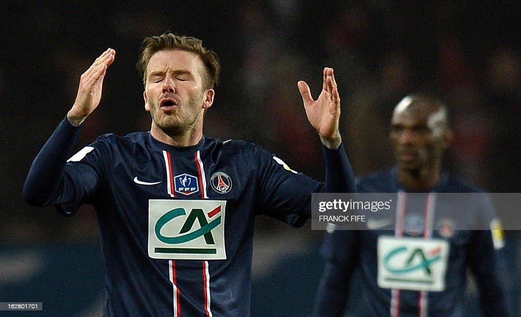 Paris Saint-Germain's English midfielder David Beckham (L) reacts during the French Cup football match Paris Saint-Germain (PSG) vs Olympique de Marseille (OM) on February 27, 2013 at the Parc-des-Princes stadium in Paris.