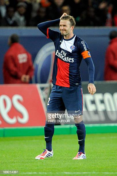 Paris SaintGermain's English midfielder David Beckham rues a missed chance during a French L1 football match between Paris St Germain and Brest on...