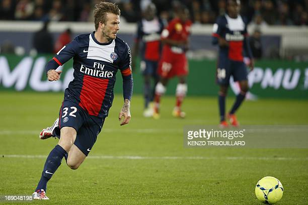 Paris SaintGermain's English midfielder David Beckham runs during a French L1 football match between Paris St Germain and Brest on May 18 2013 at...