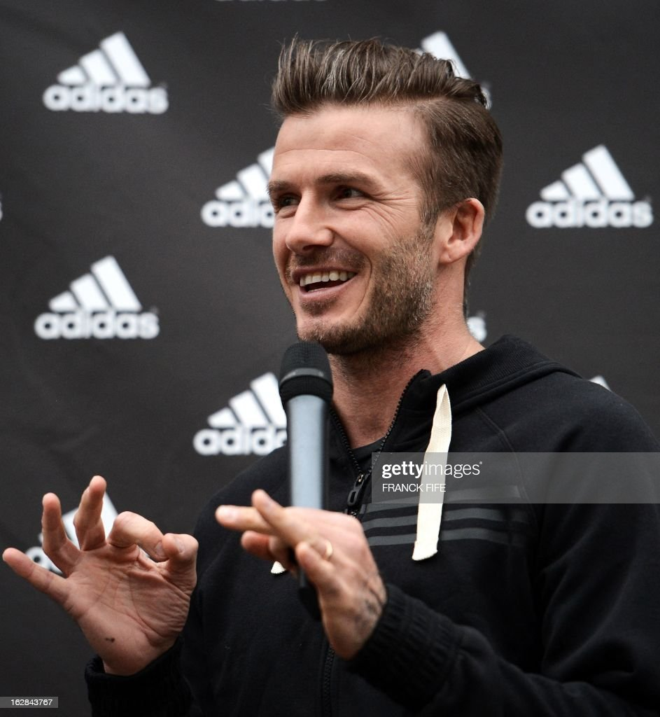 Paris Saint-Germain's (PSG) English midfielder David Beckham speaks in a store of his sponsor on the Champs-Elysees avenue in Paris, on February 28, 2013. Beckham and French former international player, Zinedine Zidane have autographed balls and jerseys for thirty fans selected via Twitter. AFP PHOTO/ FRANCK FIFE