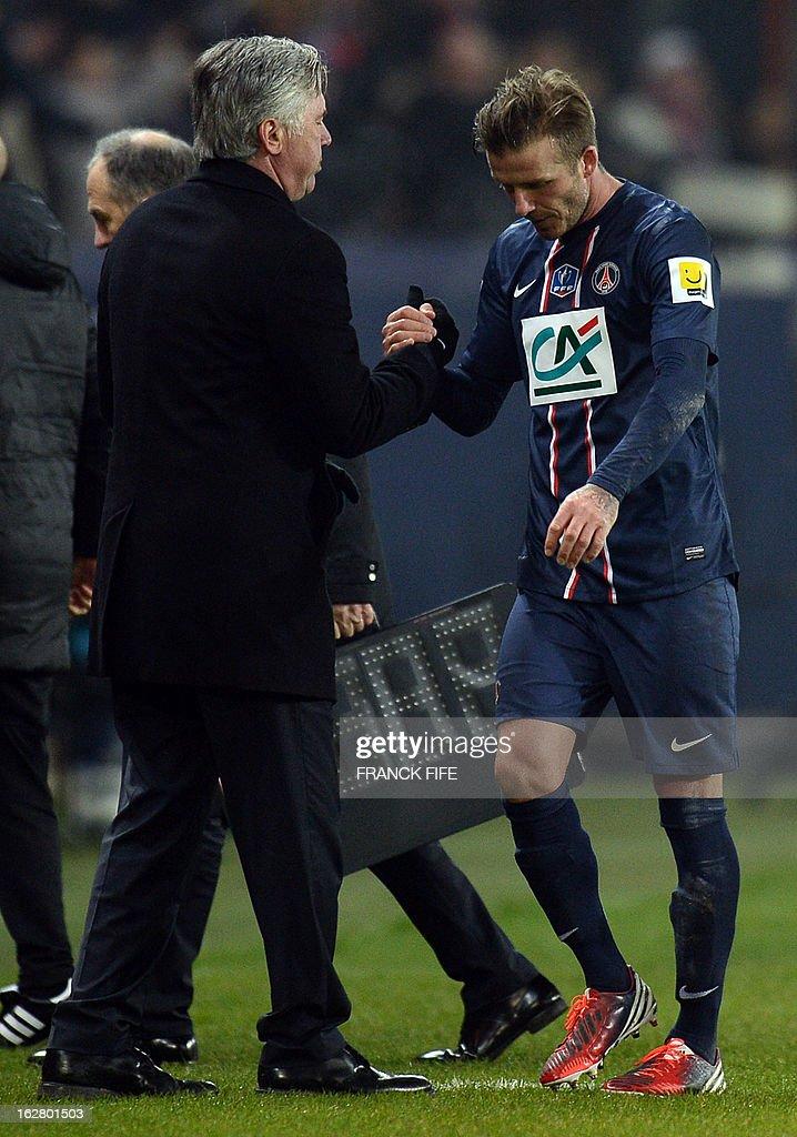 Paris Saint-Germain's English midfielder David Beckham (R) speaks with Paris Saint-Germain's coach Carlo Ancelotti as he leaves the pitch during the French Cup football match Paris Saint-Germain vs Marseille on February 27, 2013 at the Parc des Princes stadium in Paris.