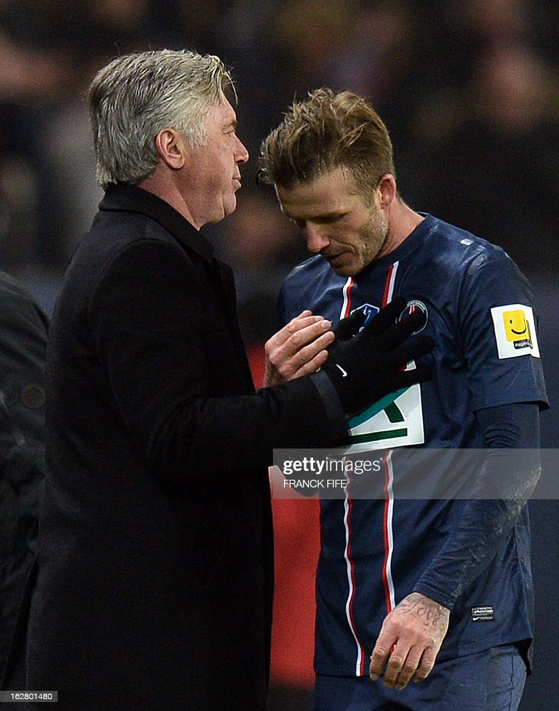Paris Saint-Germain's English midfielder David Beckham talks to Paris Saint-Germain's coach Carlo Ancelotti as he leaves the pitch during the French Cup football match Paris Saint-Germain (PSG) vs Olympique de Marseille (OM) on February 27, 2013 at the Parc-des-Princes stadium in Paris. AFP PHOTO / FRANCK FIFE