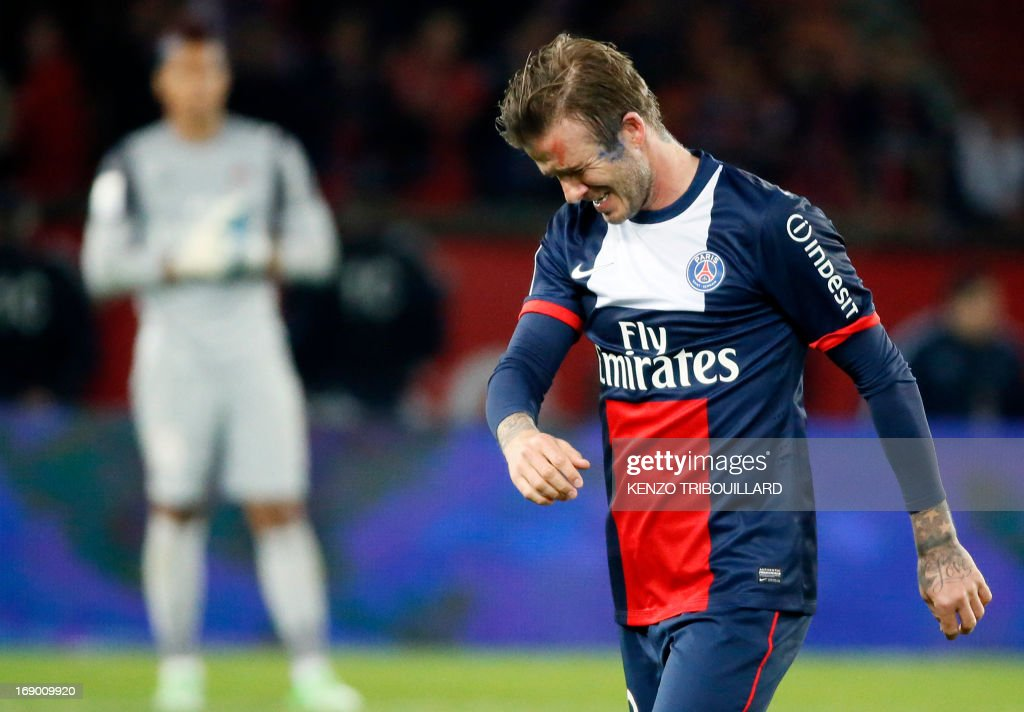 Paris Saint-Germain's English midfielder <a gi-track='captionPersonalityLinkClicked' href=/galleries/search?phrase=David+Beckham&family=editorial&specificpeople=158480 ng-click='$event.stopPropagation()'>David Beckham</a> walks off the pitch after the French L1 football match between Paris St Germain and Brest on May 18, 2013 at Parc des Princes stadium in Paris.