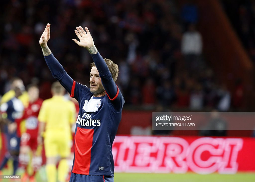 Paris Saint-Germain's English midfielder <a gi-track='captionPersonalityLinkClicked' href=/galleries/search?phrase=David+Beckham&family=editorial&specificpeople=158480 ng-click='$event.stopPropagation()'>David Beckham</a> waves after the French L1 football match between Paris St Germain and Brest on May 18, 2013 at Parc des Princes stadium in Paris.