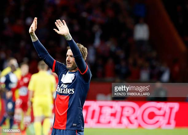 Paris SaintGermain's English midfielder David Beckham waves after the French L1 football match between Paris St Germain and Brest on May 18 2013 at...