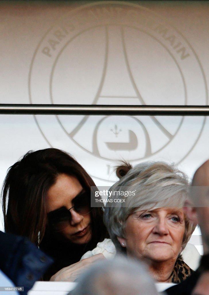 Paris Saint-Germain's English midfielder David Beckham's mother (R) Sandra and wife Victoria (L) attend the French L1 football match Paris Saint-Germain vs Nancy, on March 9, 2013 at the Parc-des-Princes stadium in Paris. AFP PHOTO / THOMAS COEX