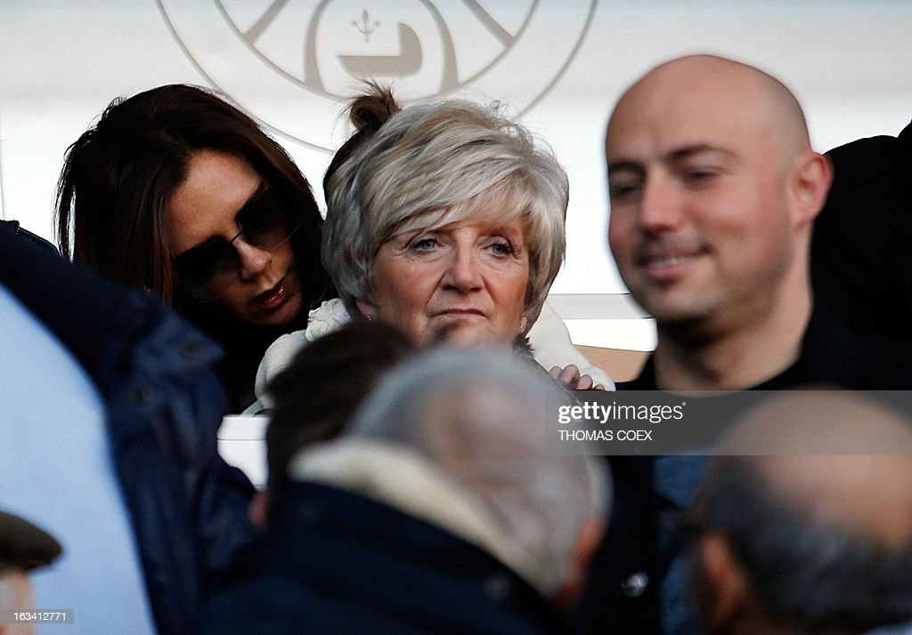 Paris Saint-Germain's English midfielder David Beckham's mother (C) Sandra and wife Victoria (L) attend the French L1 football match Paris Saint-Germain vs Nancy, on March 9, 2013 at the Parc-des-Princes stadium in Paris.
