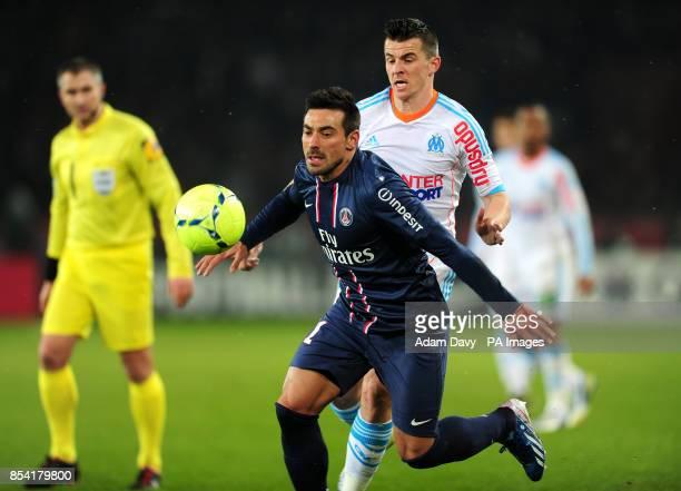 Paris SaintGermain's Ezequiel Lavezzi and Olympique de Marseille's Joey Barton battle for the ball