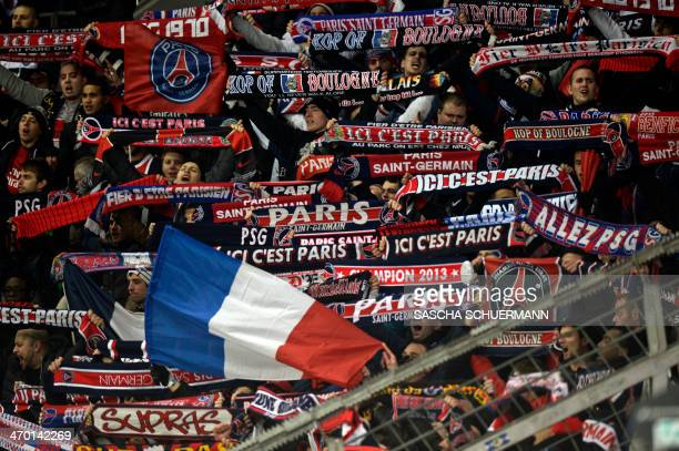 Paris SaintGermain's fans cheer prior to the firstleg round of 16 UEFA Champions League football match Bayer 04 Leverkusen vs Paris SaintGermain in...