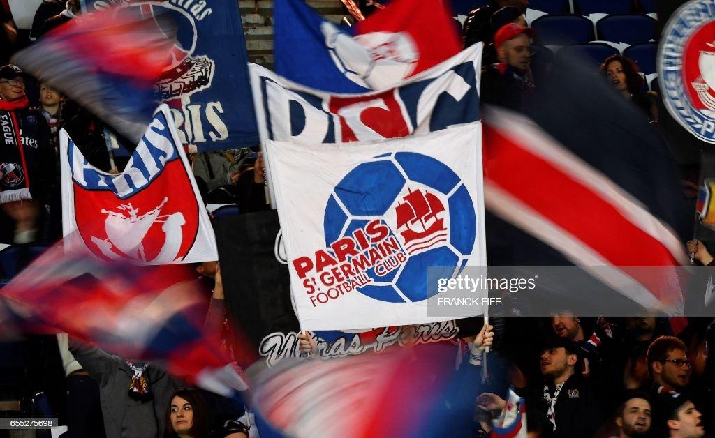 Paris Saint-Germain's fans cheer prior to the French L1 football match Paris Saint-Germain (PSG) vs Olympique Lyonnais (OL) at the Parc des Princes stadium in Paris on March 19, 2017. /