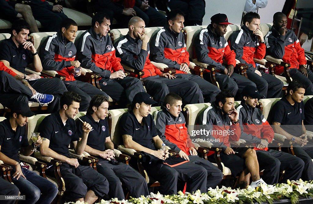 Paris Saint-Germain's (PSG) football players attend a 2013 ATP Qatar Open tennis match in Doha on January 1, 2013.